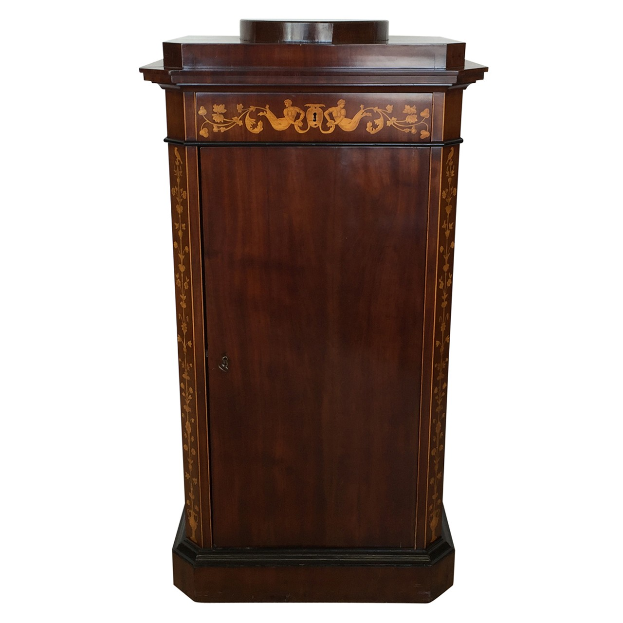 Continental mahogany cabinet with floral decorated inlay. Ca 1840.